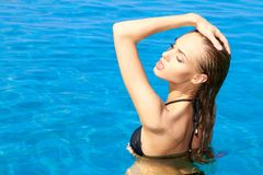 Sensual woman in swimming pool Royalty Free Stock Images