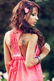 Sensual woman with tattoo on her back. Sensual redhead woman with tattoo on her back stock photography