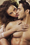 Sensual woman touching her boyfriend's perfect body Stock Images