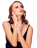 Sensual woman touching her face Royalty Free Stock Images