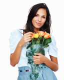 Sensual woman touching petal on bouquet of roses Royalty Free Stock Photos