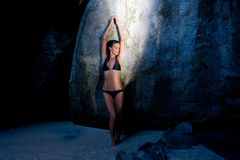 Sensual woman tropical  resort cave Royalty Free Stock Image