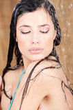 Sensual woman under shower. In tropical environment Stock Photo