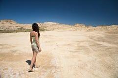 Sensual woman walking at the desert Royalty Free Stock Image