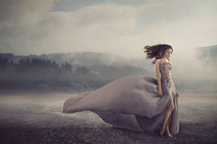 Sensual woman walking on the fantasy ground Royalty Free Stock Photo