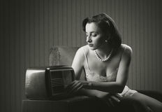 Sensual woman listening music on old radio Royalty Free Stock Photos
