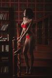 Sensual woman  wearing lingerie posing on stair Royalty Free Stock Images