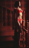 Sensual woman  wearing lingerie posing on stair Royalty Free Stock Photo