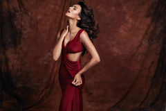 Sensual woman wearing red dress Stock Image