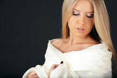 Sensual woman in white cloths Stock Images