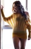 Sensual woman on window Stock Image