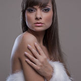 Sensual woman with withe fur. Sexy woman with great skin and gray background Stock Photos