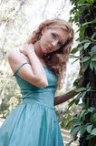 Sensual woman in woods. Sensual woman in emerald dress in woods Royalty Free Stock Image