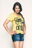 Sensual woman in yellow top. In studio Stock Photos