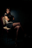 Sensual women on a chair Royalty Free Stock Photography
