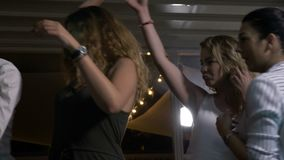Sensual women dancing with each other fooling around at disco club stock video