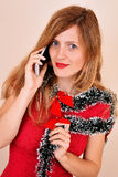 blonde girl talking on the phone stock photo