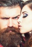 Sensual woman kiss bearded man, love. Woman with makeup skin and hipster with long beard. Couple in love and family stock photos
