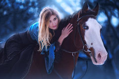 Sensual young beauty riding a horse Royalty Free Stock Photos