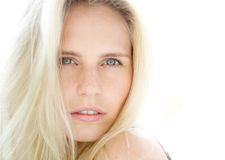 Sensual young blond woman with blue eyes. Close up portrait of a sensual young blond woman with blue eyes Royalty Free Stock Photo