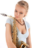 Sensual young blonde with saxophone Stock Photo