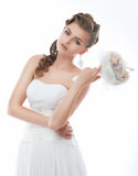 Sensual young bride with bouquet of flowers posing Royalty Free Stock Photos