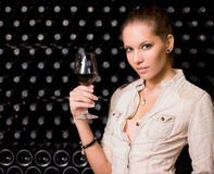 Sensual young brunette with glass of wine. Royalty Free Stock Photo