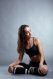 Sensual young brunette posing in lotus position Royalty Free Stock Photo
