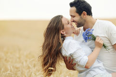Sensual young couple having fun outdoor in summer field Royalty Free Stock Photo