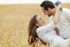 Sensual young couple having fun in summer field Royalty Free Stock Photos