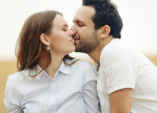 Sensual young couple kissing in summer field Stock Photo