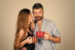 Sensual young couple making love. Perfect morning with coffee. Family of men and women with red milk cup. Refreshment and energy, break. men and girl with Stock Photo