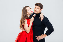Sensual young couple playing and posing with gun Stock Images