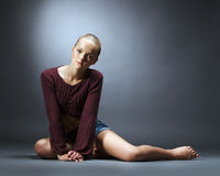 Sensual young girl advertises fashionable clothes Royalty Free Stock Photography