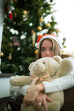 Sensual young girl hugs teddy bear in christmas eve Royalty Free Stock Images