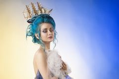 Sensual young girl with naked shoulders and painted blue hair st stock photography