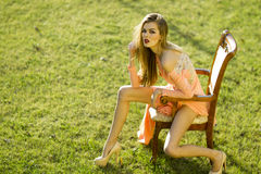 Sensual young girl in peach dress Royalty Free Stock Photo
