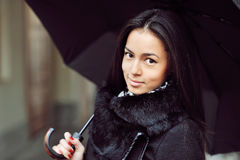 Sensual young girl portrait with umbrella in a rainy weather. Outdoors stock photography