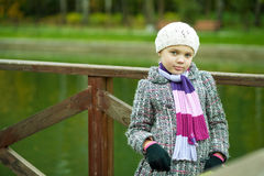 Sensual young girl standing near river. In white beret with calm face expression Stock Photography