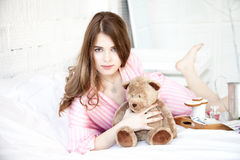 Sensual young girl with teddy bear Royalty Free Stock Photography