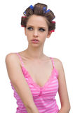 Sensual young model in hair curlers posing Stock Image