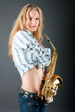 Sensual young pretty sexy blonde with sax Stock Images