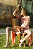 Sensual young pretty woman in peach dress Royalty Free Stock Images