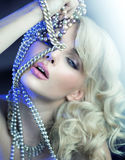 Sensual young woman witrh silver jewelary Stock Images