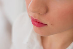 Sensual young woman applying cosmetics on her lips Royalty Free Stock Images