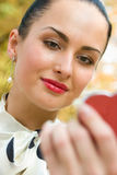 Sensual young woman applying lipstick Royalty Free Stock Image
