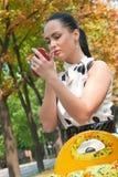 Sensual young woman applying lipstick. Sensual young woman using lipstick macro shot Royalty Free Stock Photo