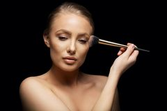 Sensual young woman applying make up Stock Photography