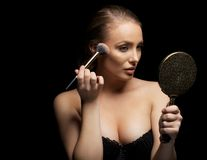 Sensual young woman applying make up Royalty Free Stock Images
