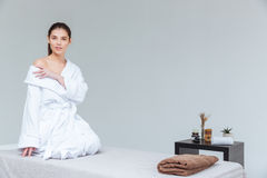 Sensual young woman in bathrobe sitting in spa salon Royalty Free Stock Photography